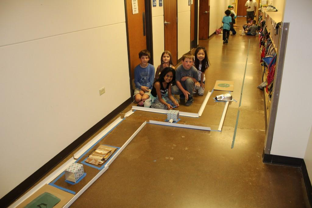 Third graders create mazes for Sphero robots to navigate through.