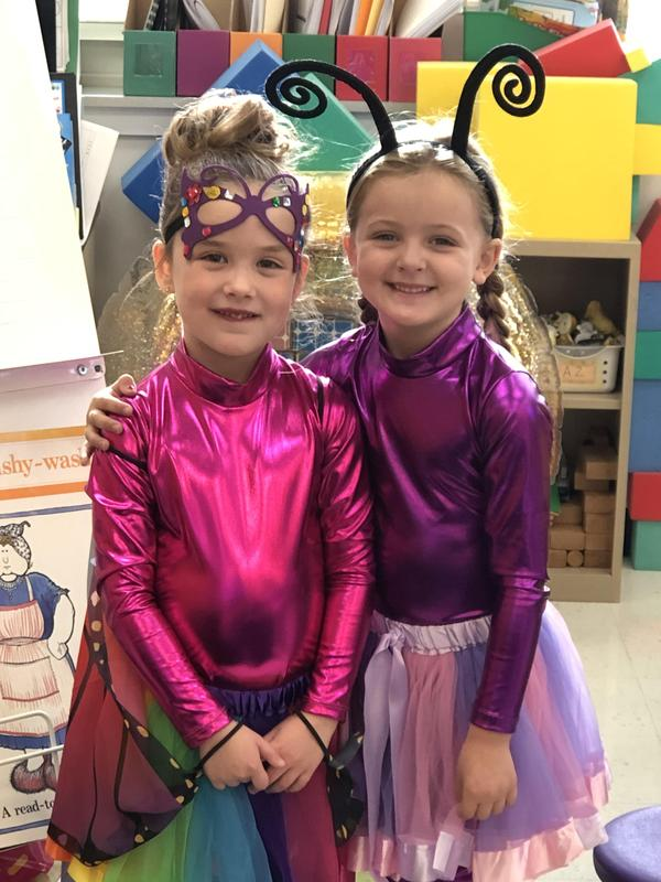 Photo of two kindergartners in costume for Halloween.