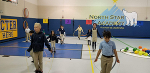 Elementary school students jumping rope.