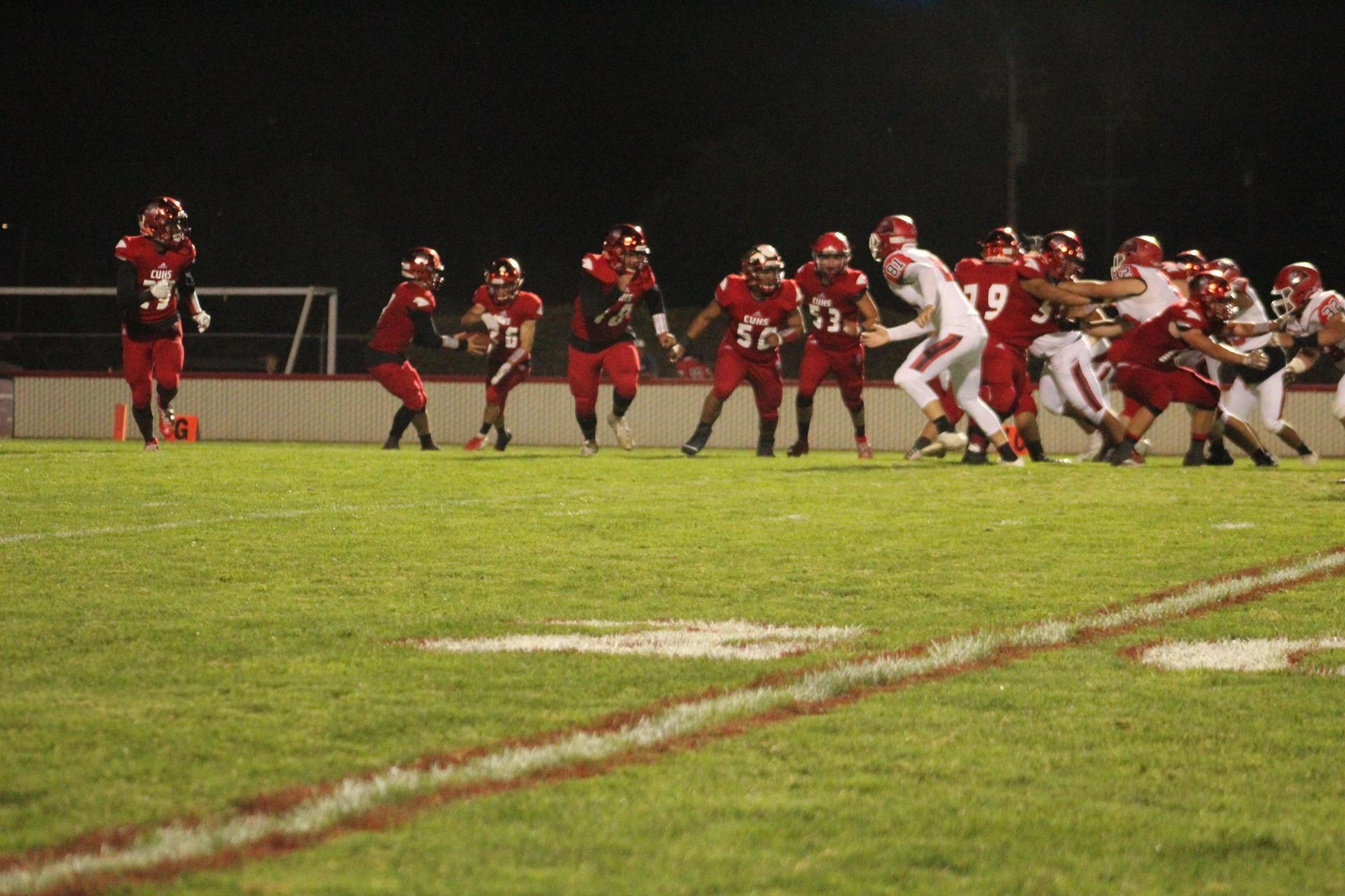 Varsity Boys playing Football against Kerman