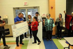 Education check presentation at Mims Elementary