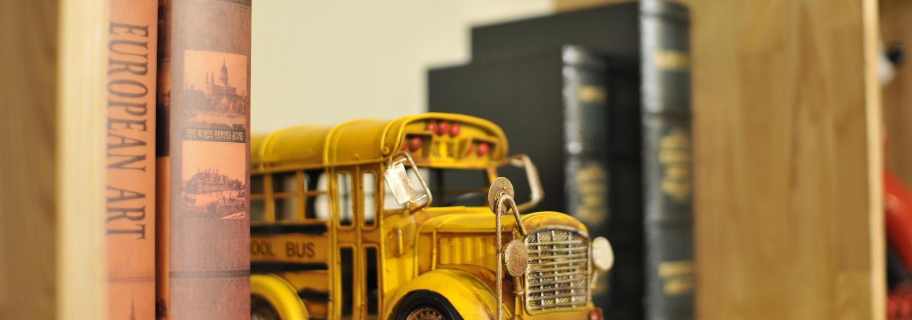 Books and toy bus