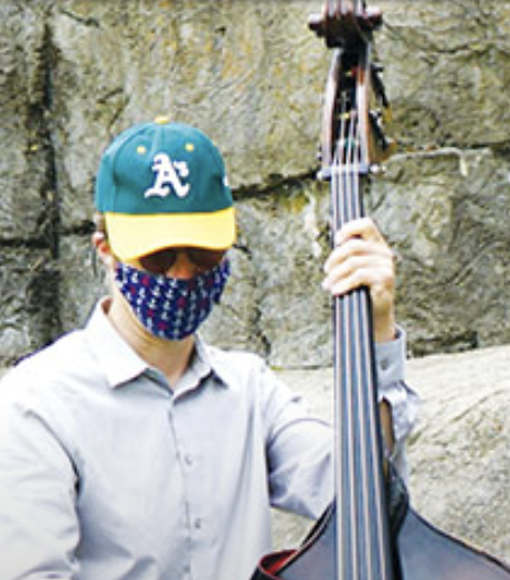 Bay School music teacher and jazz musician Colin Williams plays stand-up bass
