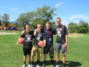 TKHS football players volunteer time at Lee playground.