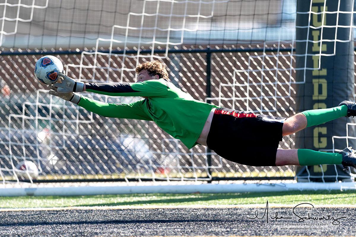 Boys Soccer Diving Save