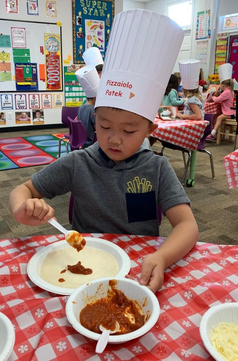Primary Center Boy Making Pizza