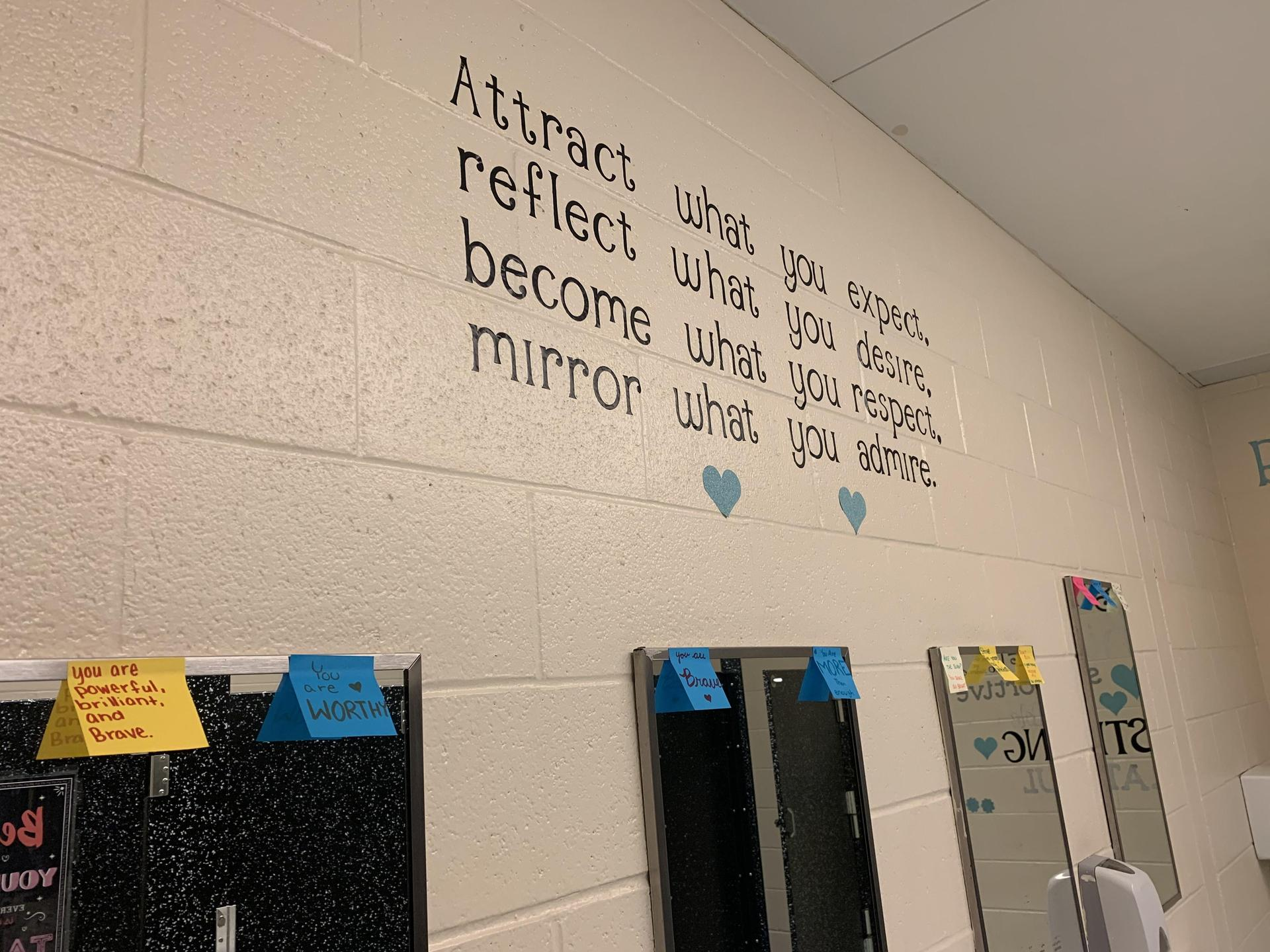 Pic of bathroom mirror with positive messages from students to students