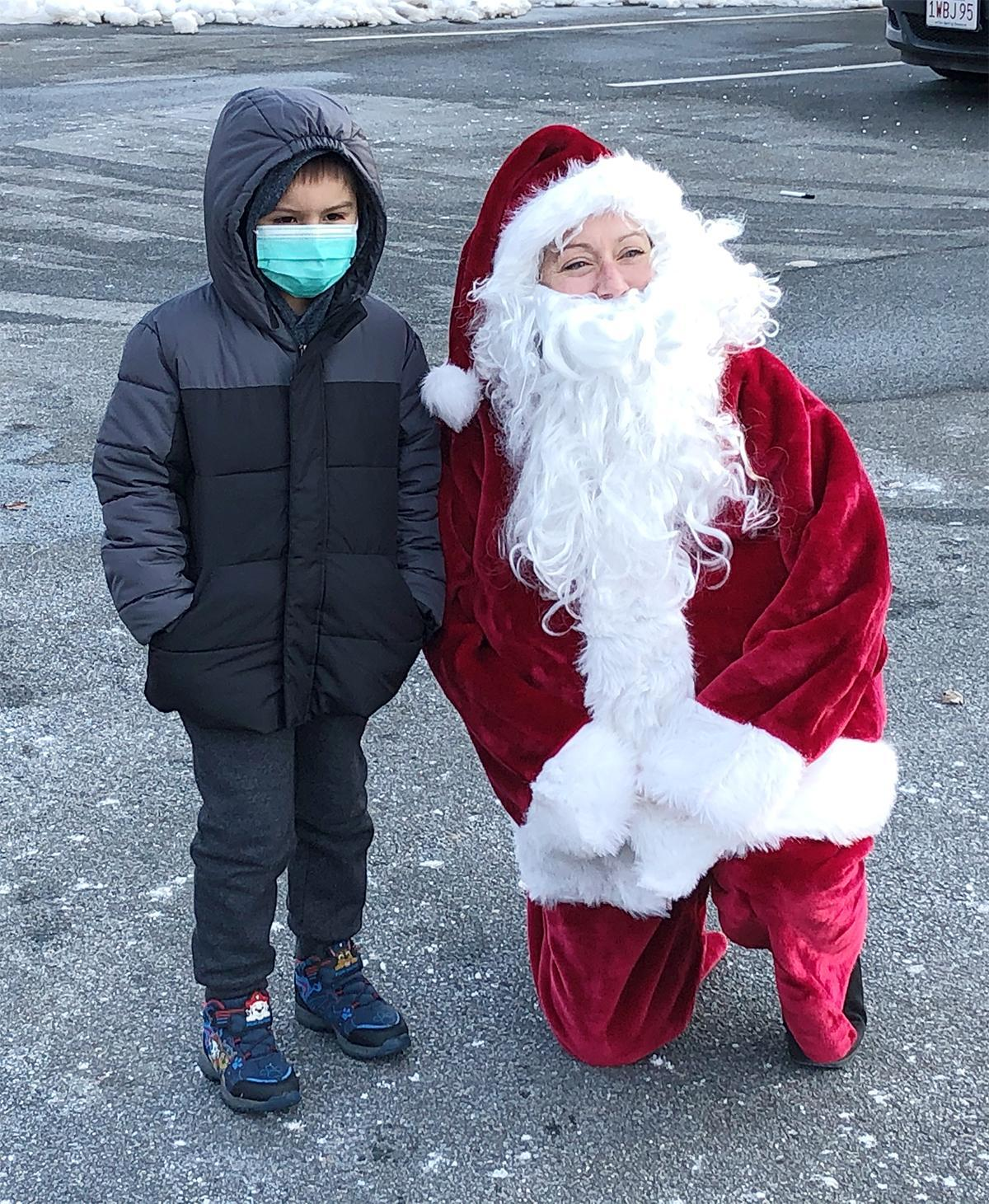 Santa and a young student