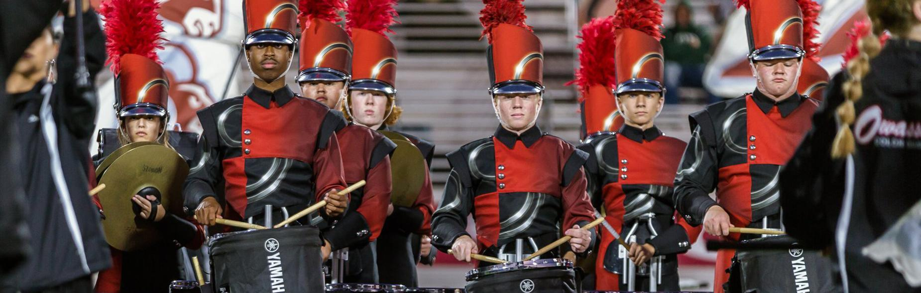 Pride of Owasso Marching Band drummers.