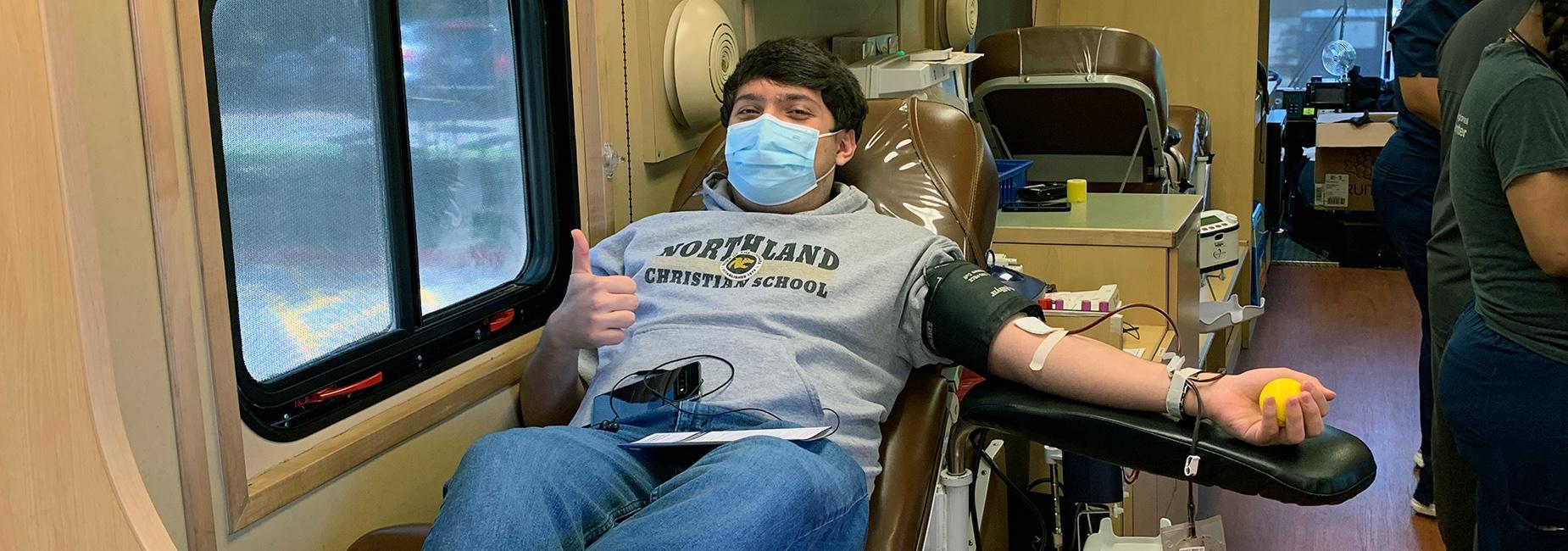 student giving blood
