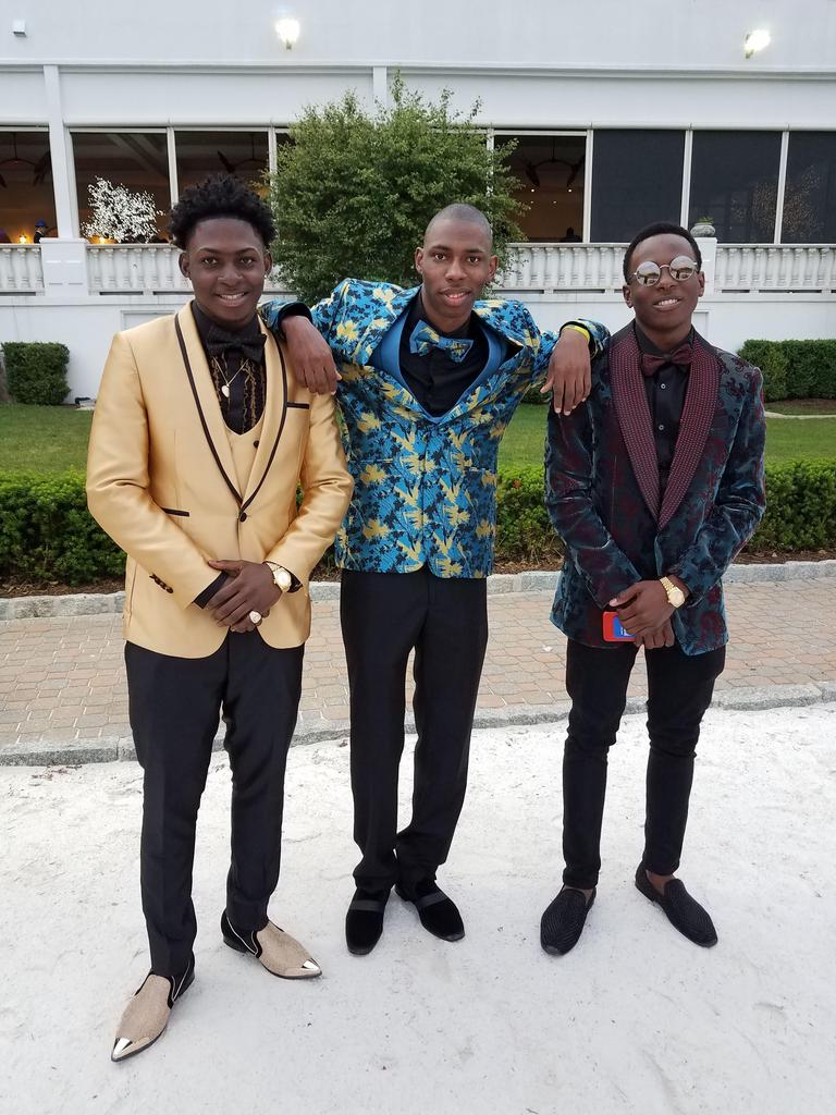 three suited students