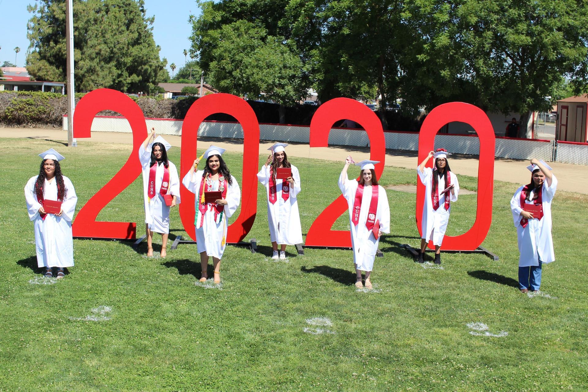 Left to right, Vanessa Yuriar, Sandra Chavez, Jennifer Pelayo, Josephine Moore, Lillian Sandlin, Abhineet Singh, and Jessalyn Guardado turning their tassels