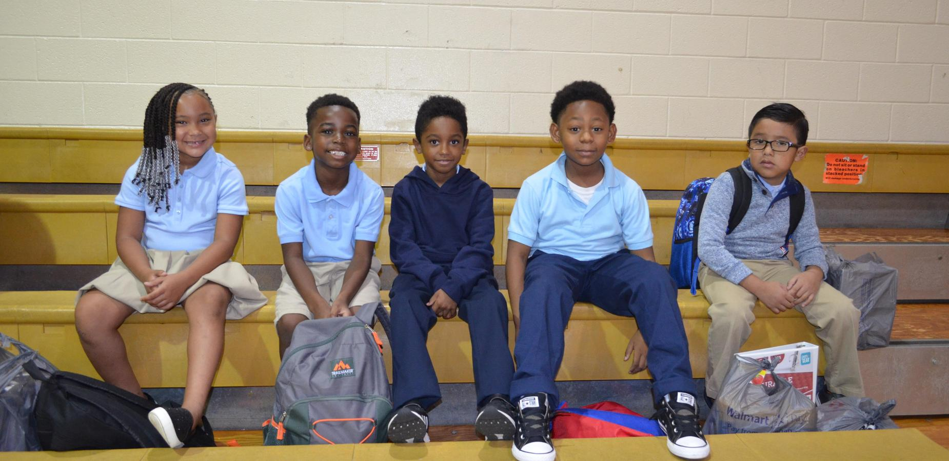Students enjoying the first day of school assembly.