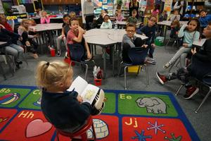 Kinzie reads in braille to a second grade class