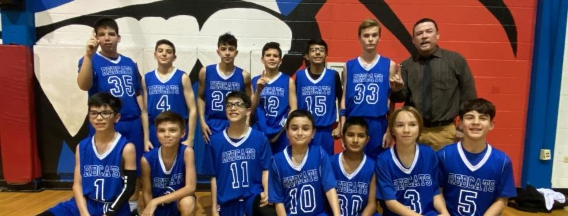7th Grade Basketball Team ends season with a perfect record