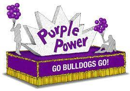 Purple and Gold Homecoming float that says Purple Power and Go Bulldogs Go