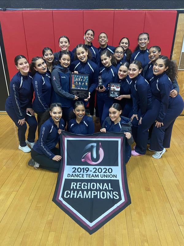 UCHS Drillettes Dance Team With winning flag