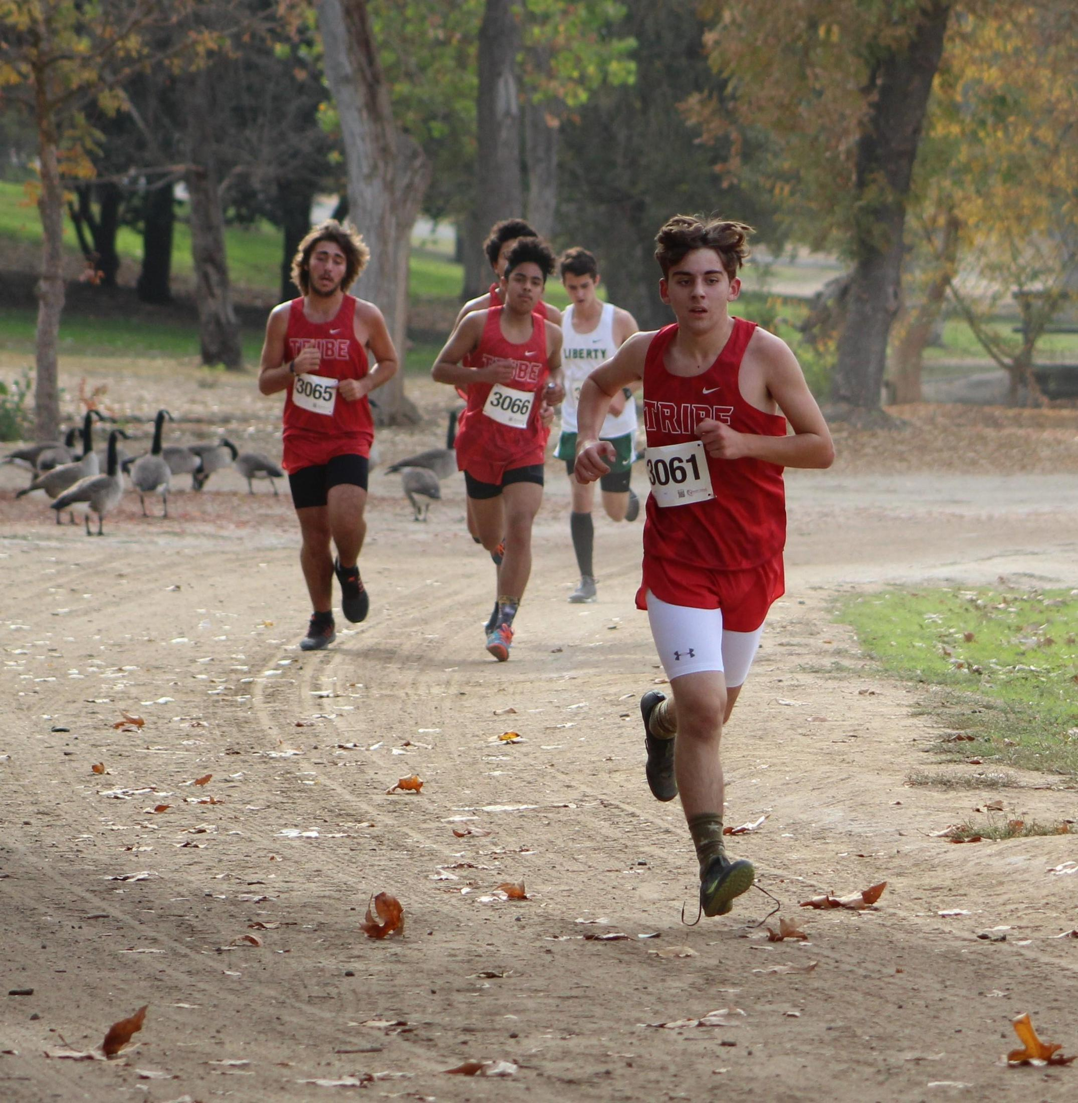 Carson Borba, Antonio Brasil, and Angel Gonzales running