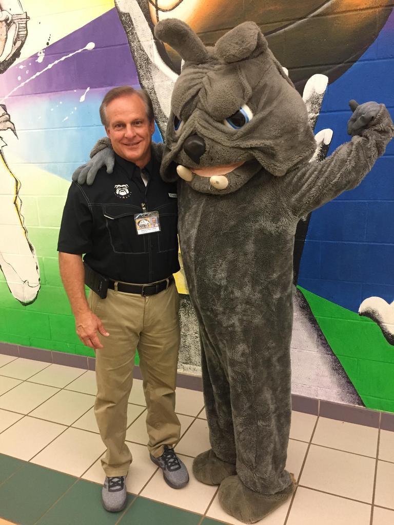 Principal Carlan Martin and Spirit the Bulldog