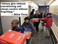 """Always give without remembering and always receive without forgetting"" - Brian Tracy, Image of students bringing donations to a food drive"