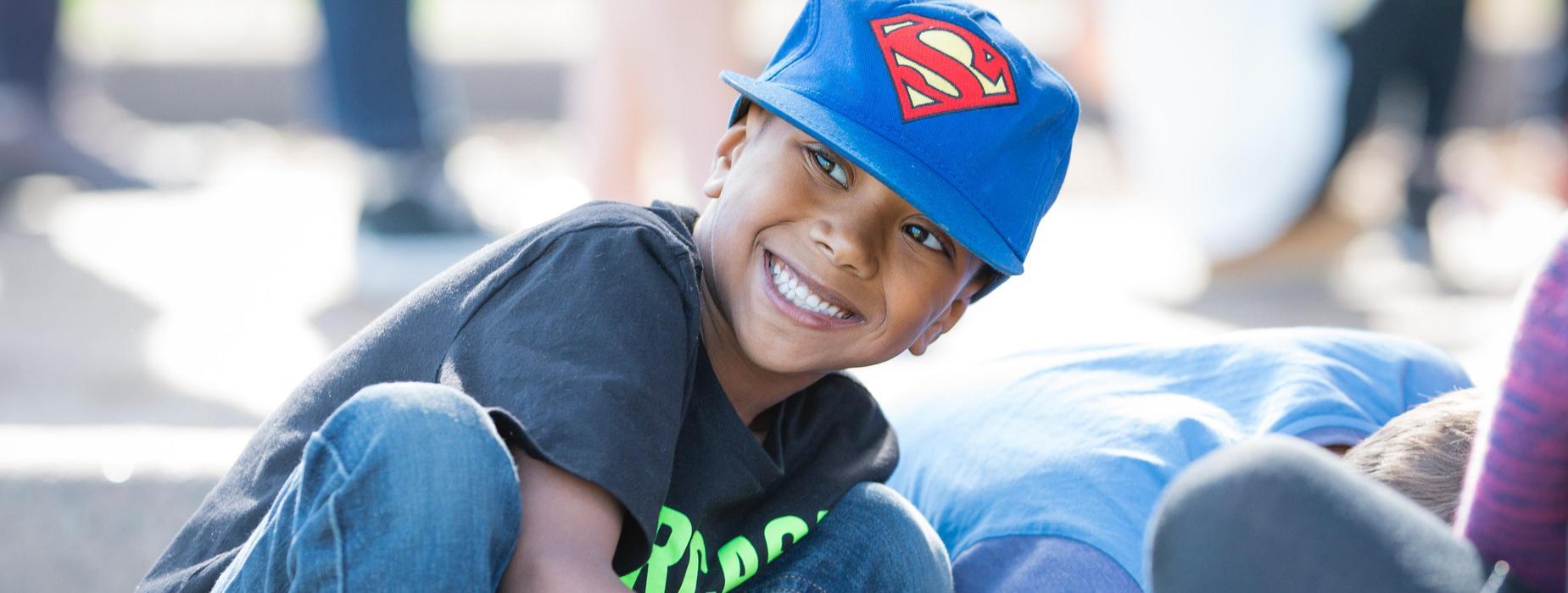 Smiling boy in blue cap. Field Day Fun!