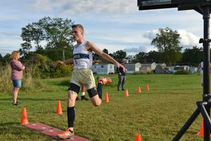 Pic of Braden Zukowski crossing finish line