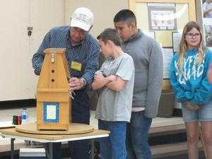 Students observe bees in enclosed hive.
