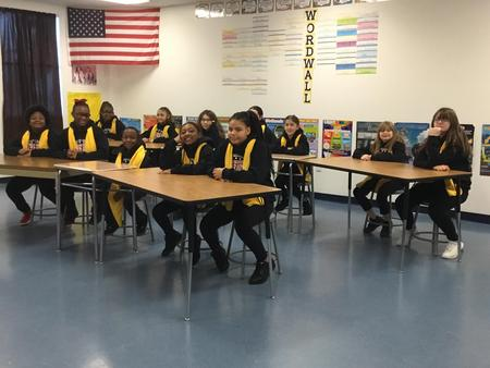 Picture of NSCW dancers sitting in the classroom.