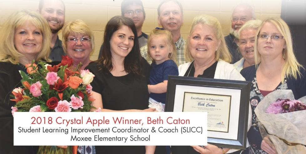 Mrs. Beth Caton (2018 - SLICC @ Moxee Elementary) accepting her award.