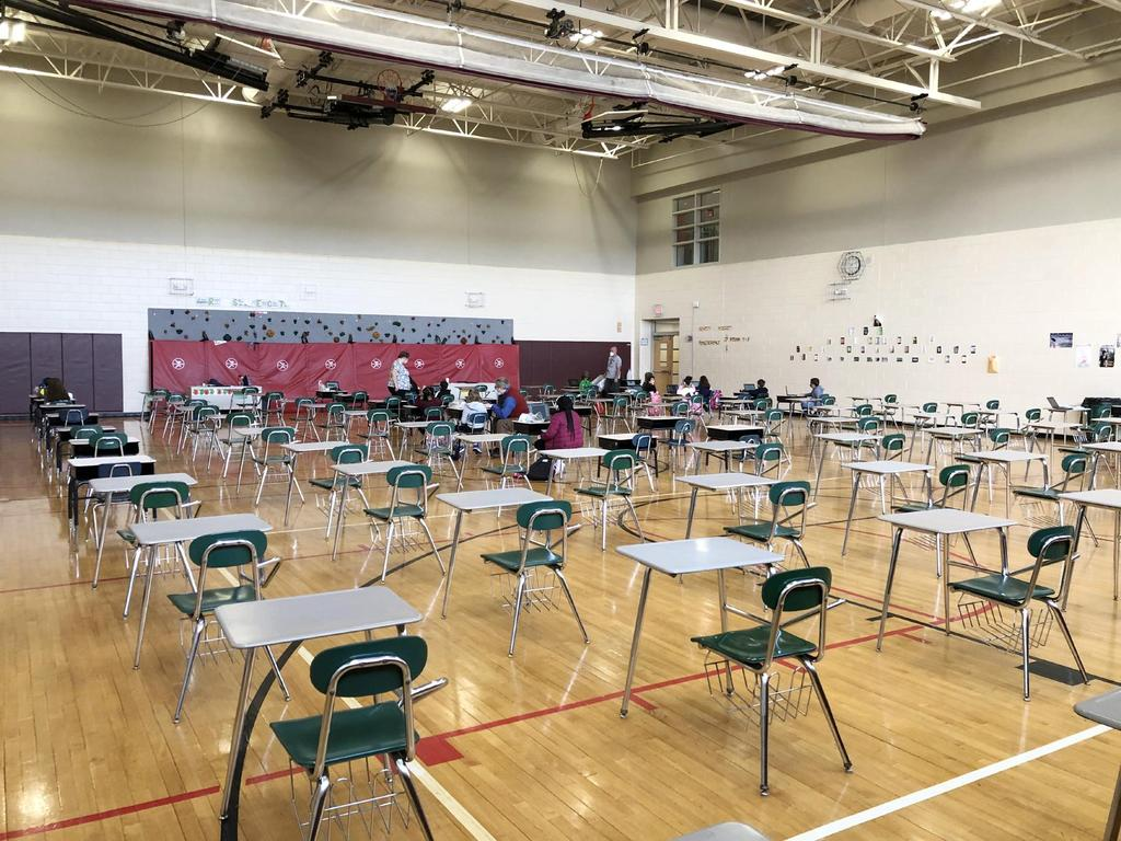 Gym filled with empty desks