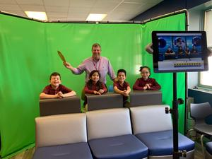 dr solter and students in spartan studios