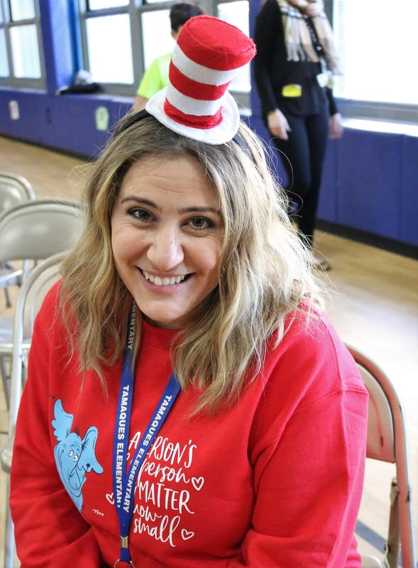 Photo of Tamaques teacher wearing Cat in the Hat hat for Read Across America Day.