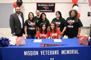 VMHS cheer squad members Alyssa Rodriguez and Aileen Ybarra sign with University of Incarnate Word.
