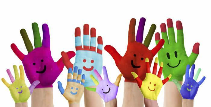Painted children's hands with smiles