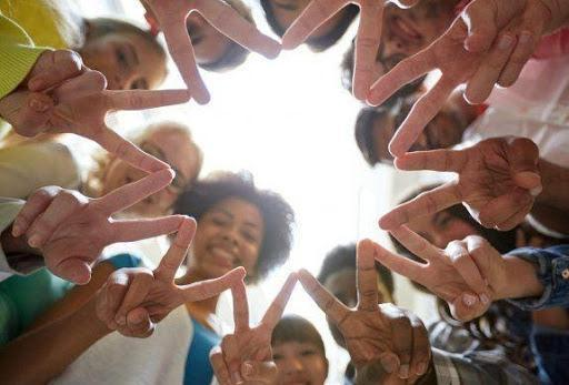 Picture of kids making a Peace sign