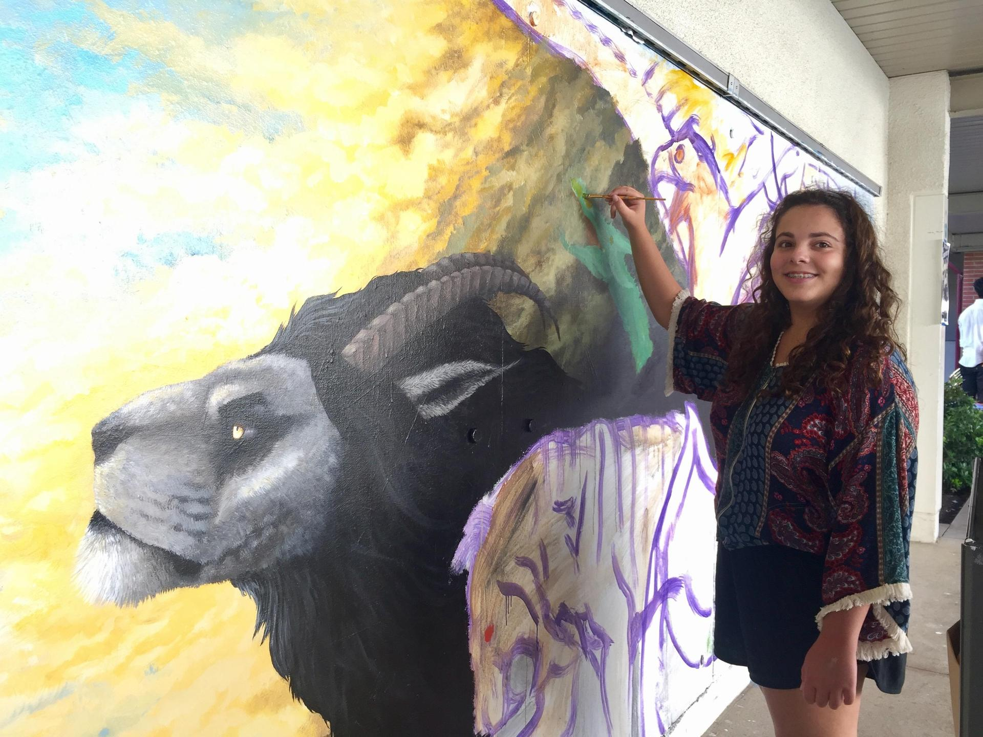 Arcadia High Student Painting Mural on campus