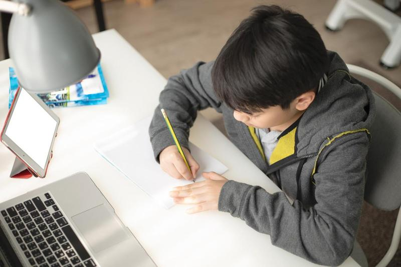 student learning remotely at his desk
