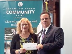 Kim McAfree receiving grant