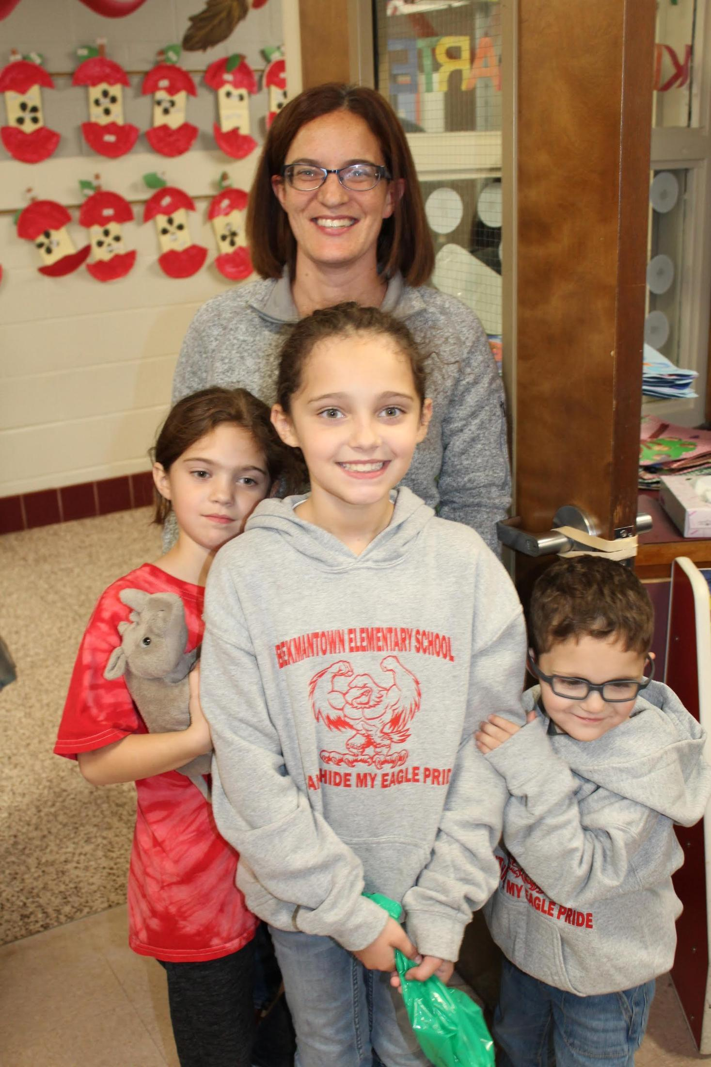 Mom and her three children at fall festival.