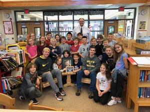 Mars Area High School technology education students pause for a picture with Mars Area Elementary School students and principal Todd Lape after delivering two adirondack chairs, a table and plaque created in memory of Elliana Boatwright, who unexpectedly passed away shortly after graduating from third grade the end of the 2018-2019 School Year.