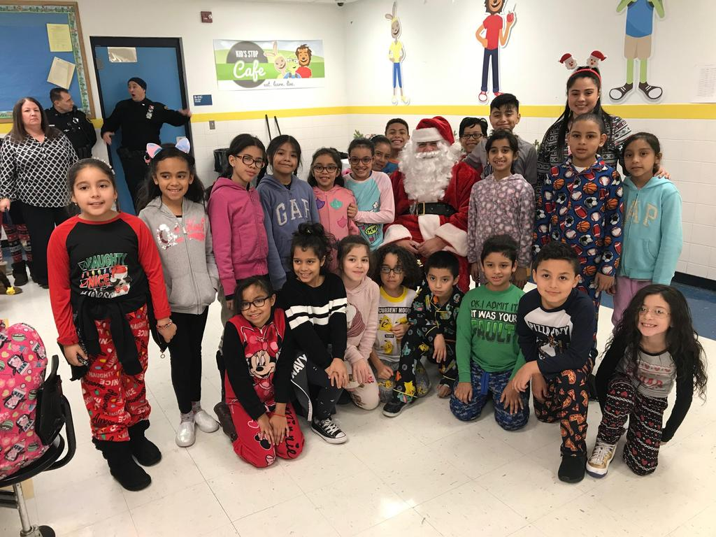3rd grade students with santa