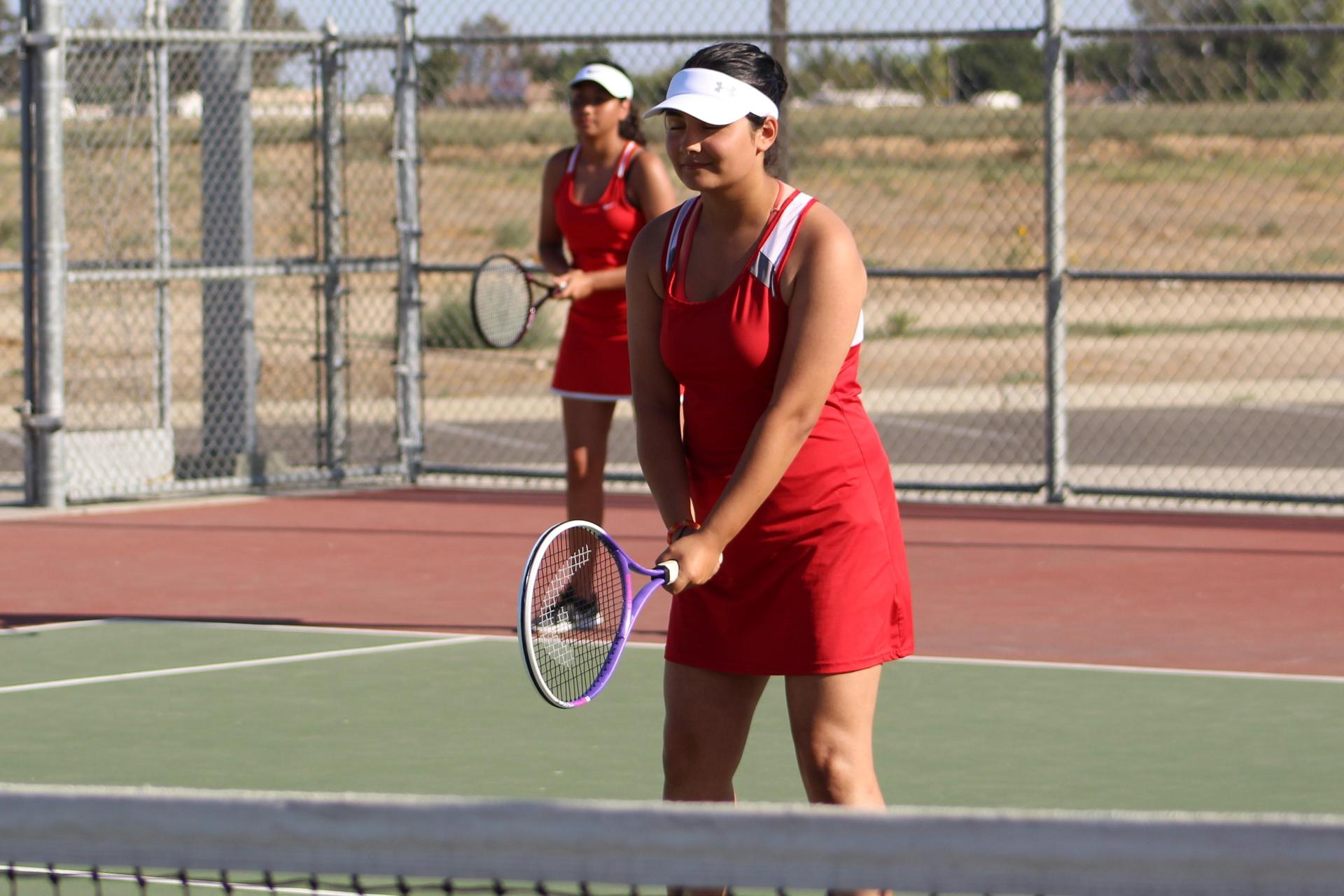 Girls playing tennis