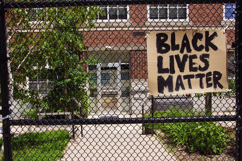 Black Lives Matter sign on the CH Fence