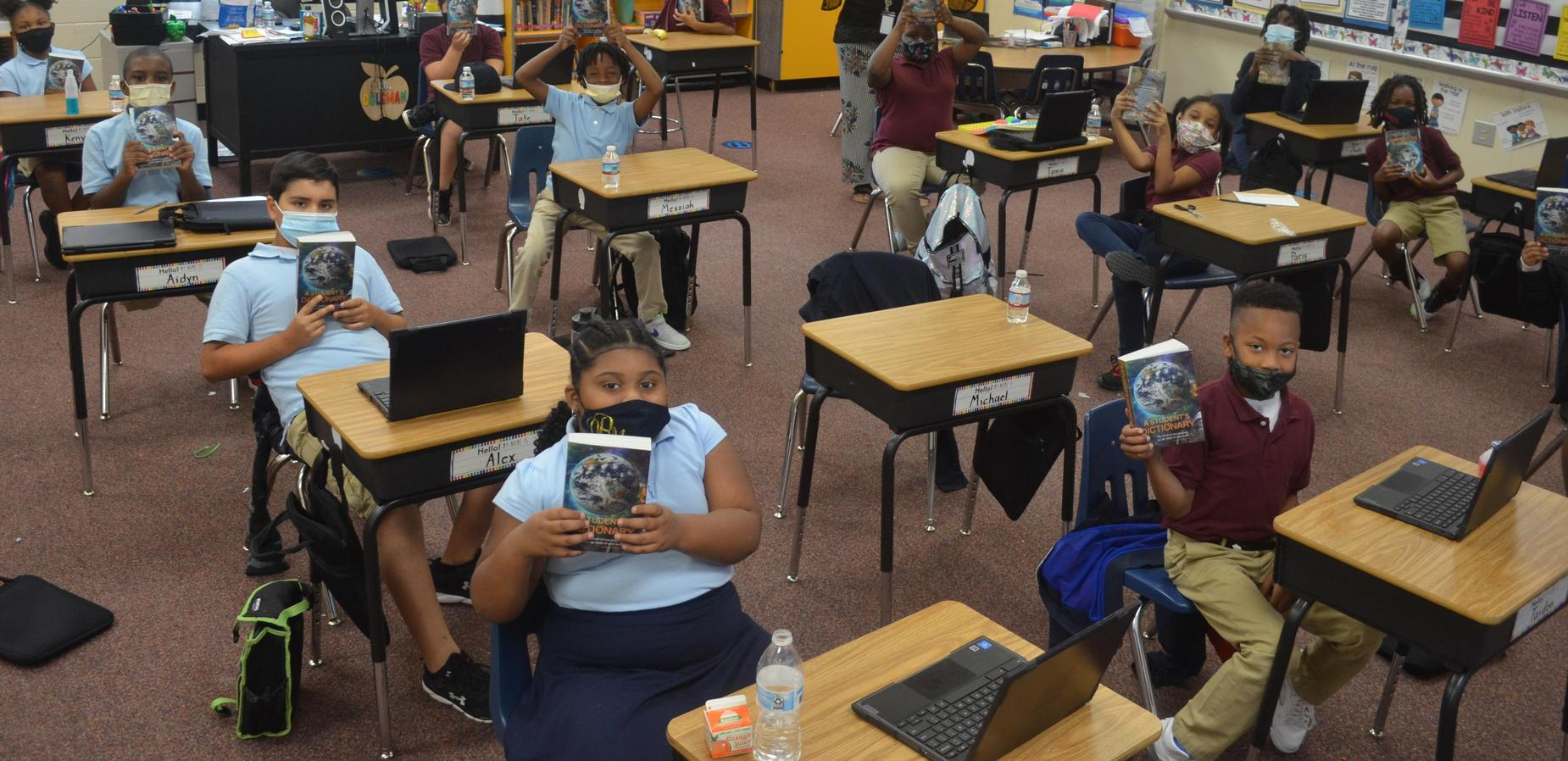 Our Third Graders are excited about the dictionaries donated by the Rotary Club!!