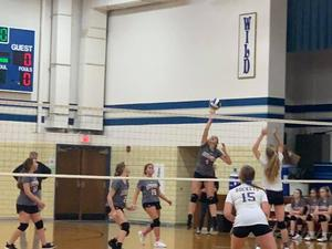 Block at the net by Kameron Koors