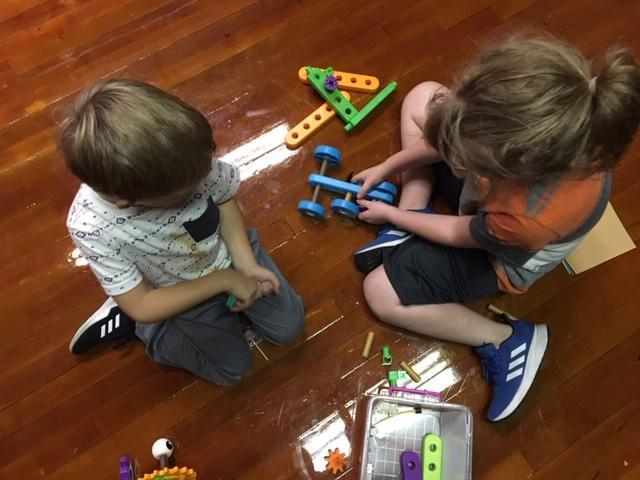 Picture of 2 boys building a car