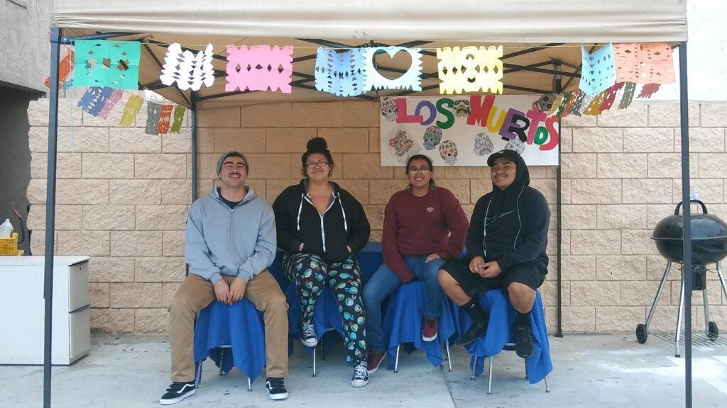 LA CAUSA students pose under papel picado