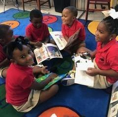 Photo of Pre-K students engaged in their own literature circle