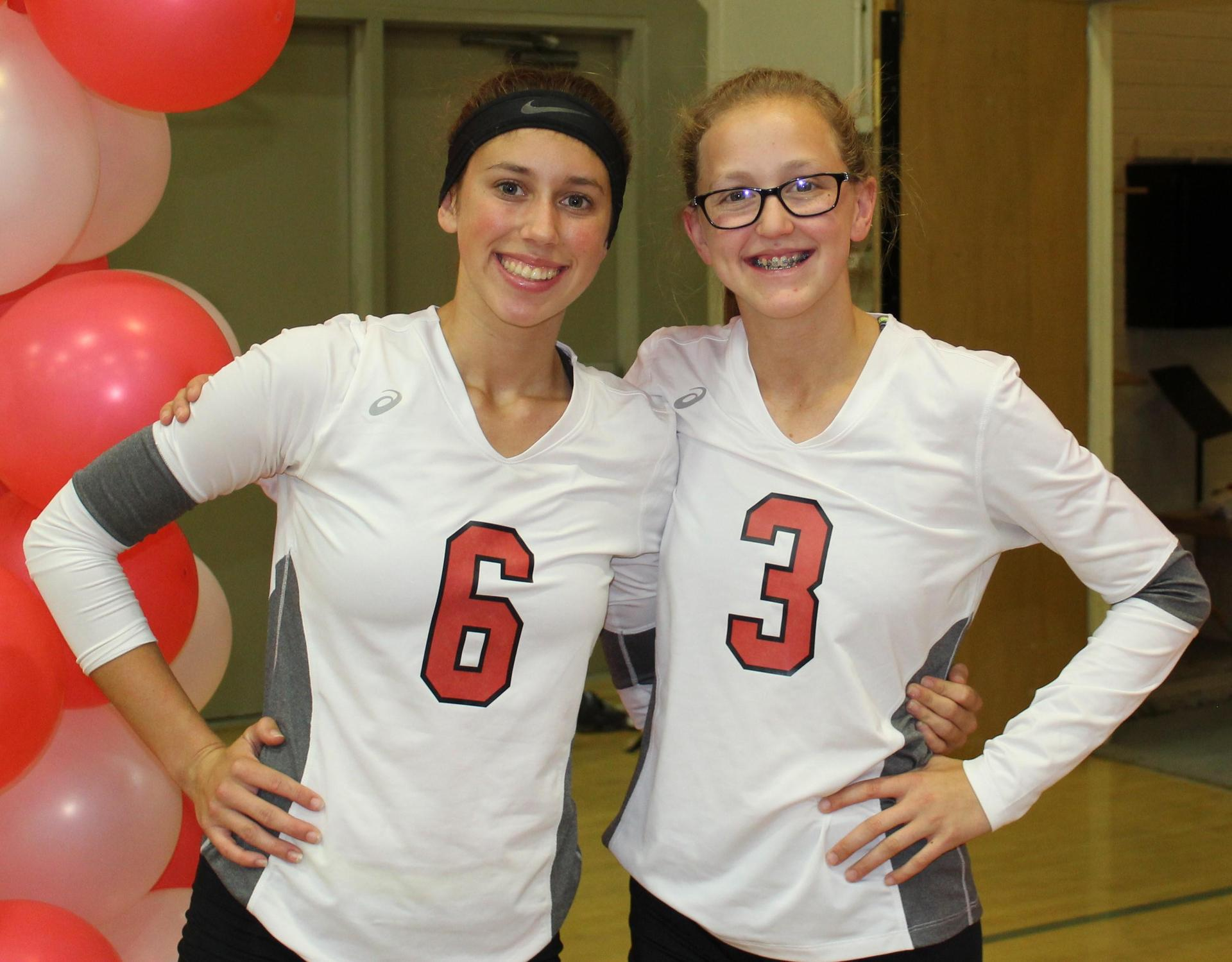 Savannah Bass and Lauren Bass pose on Volleyball Senior Night.