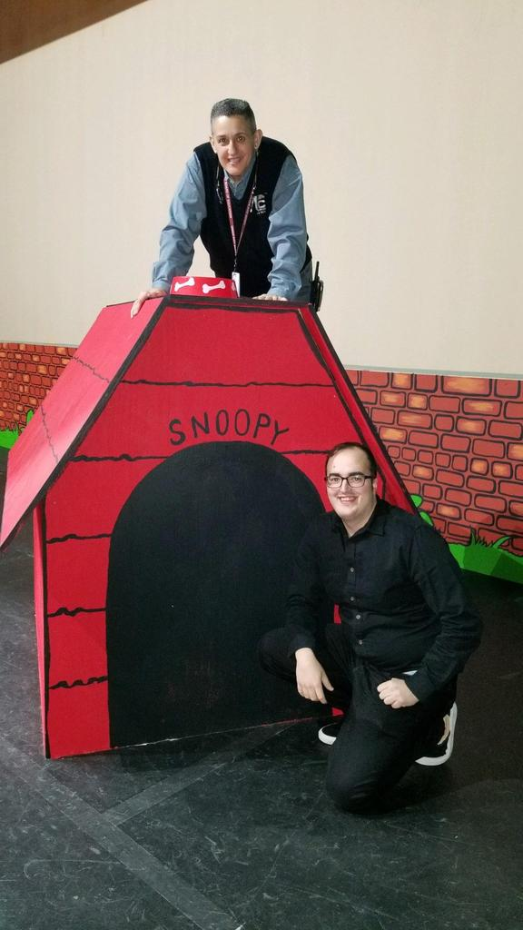 Ms. Machado on top of snoopy's house with fellow teacher